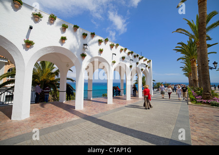 People on the Balcon de Europa promenade in resort town of Nerja on Costa del Sol, Andalusia, Spain. - Stock Photo