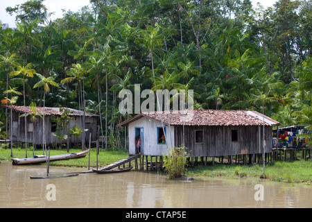 Houses on bank of Combu Island alongside side arm of Amazon river, near Belem, Para, Brazil, South America - Stock Photo