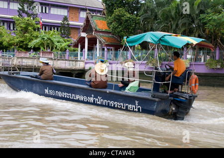 Locals on board a  high speed boat on the Bangkok Yai canal in Bangkok, Thailand - Stock Photo