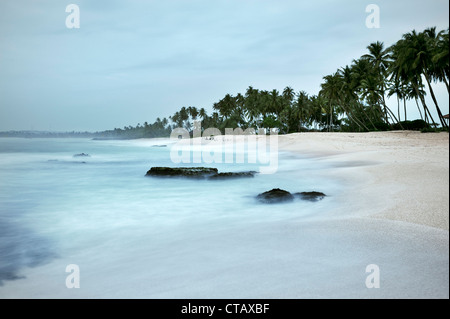 coastline of Tangalle beach at dawn, Sri Lanka, Indian Ocean, long time exposure - Stock Photo