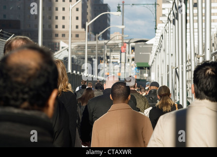 A crowd of commuters walking in lower Manhattan, NYC. - Stock Photo