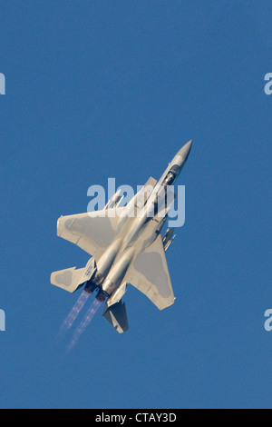 USAF McDonnall Douglas F-15C Eagle in steep climb with afterburners on - Stock Photo