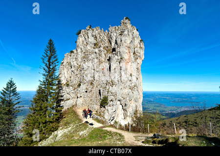 Mountaineers at Staffelstein, Kampenwand, lake Chiemsee in background, Chiemgau, Upper Bavaria, Germany - Stock Photo