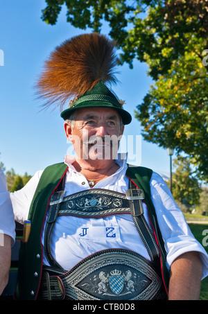 Man wearing traditional clohtes, Prien, lake Chiemsee, Chiemgau, Upper Bavaria, Germany - Stock Photo