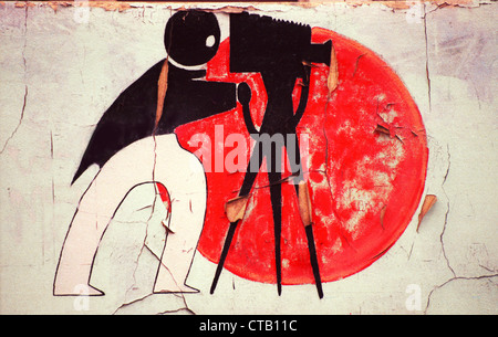 An art deco illustration of a photographer with camera and tripod decorates the wall of an abandoned building in - Stock Photo