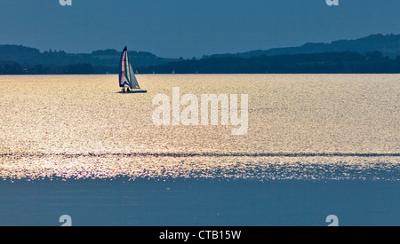 Sailboat on lake Chiemsee, Chieming, Chiemgau, Upper Bavaria, Germany - Stock Photo