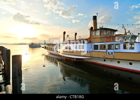 Excursion boat in harbor in the morning, Prien, lake Chiemsee, Chiemgau, Upper Bavaria, Germany - Stock Photo