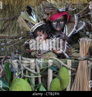 Baby girl with doll as symbol of Santo Nino figur, Ati Atihan festival, Ibaja, Aklan, Panay Island, Asiay, Ibajay, - Stock Photo