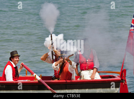 British sailor re enactors fire in support of the infantry beach assault - Stock Photo