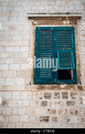 Old window in Dubrovnik background - Stock Photo