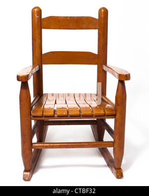 A worn child's rocking chair isolated on white - Stock Photo