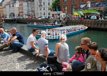 Nyhavn crowded with tourists and jazz fans on a sunny summer day during the Copenhagen Jazz Festival. Copenhagen, - Stock Photo