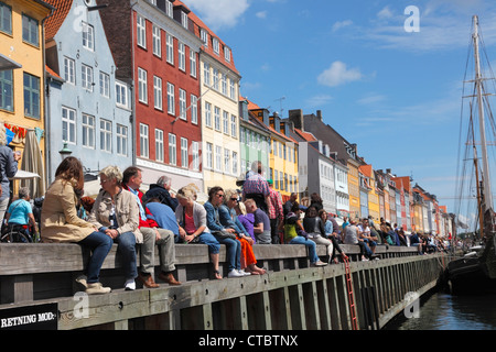 Nyhavn quay crowded with tourists and jazz fans on a sunny summer day during The Copenhagen Jazz Festival. Copenhagen, - Stock Photo