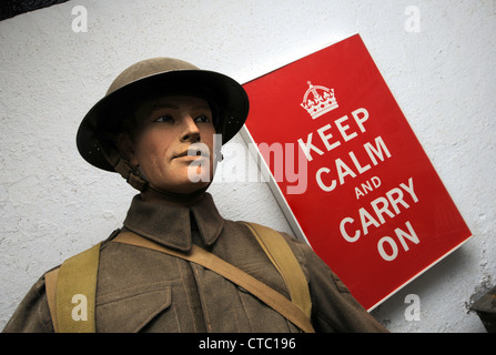 Keep Calm and Carry On poster by a model of a British soldier - Stock Photo