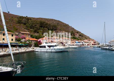 Boats in the small port of Capraia Island, Tuscan Archipelago, Italy. - Stock Photo