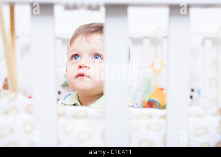 little toddler playing in the child's room - Stock Photo
