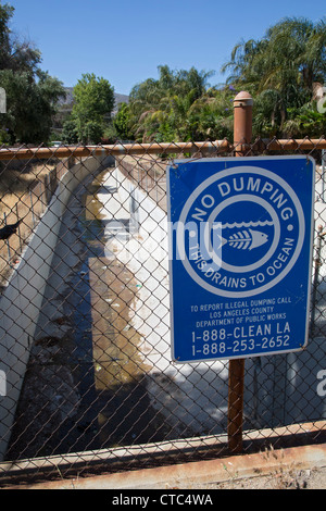 Sylmar, California - A sign warns against illegal dumping in a canal that drains storm water to the Pacific Ocean. - Stock Photo