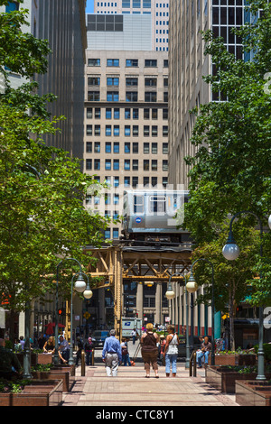 L train on The Loop viewed from Financial Place in downtown Chicago, Illinois, USA - Stock Photo