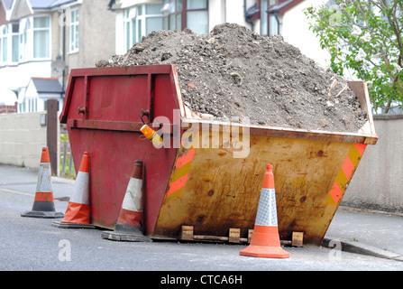 Skip, rubbish skip on residential street, Britain, UK - Stock Photo