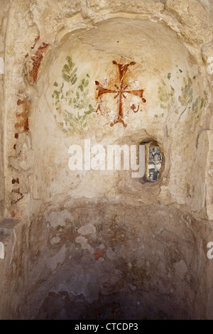 Byzantine cross painted on a wall of an ancient Roman bath in Beit She'an National Park, Israel - Stock Photo