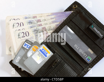 20 pound notes and one pound coins with credit card in wallet - Stock Photo