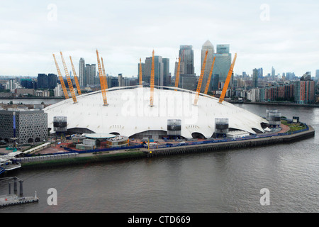 Aerial of O2 Arena on Greenwich Peninsula with Canary Wharf in background, London UK - Stock Photo