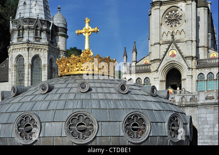 Gilded crown and cross of the Basilica of our Lady of the Rosary / Notre Dame du Rosaire de Lourdes, Pyrenees, France - Stock Photo