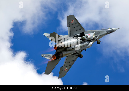 A Mikoyan Gurevich MiG-29A Fulcrum red 111 of 1.elt Polish Air Force climbing in full reheat after take-off at the - Stock Photo