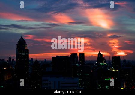 sunset over Bangkok skyline, Bangkok, Thailand - Stock Photo
