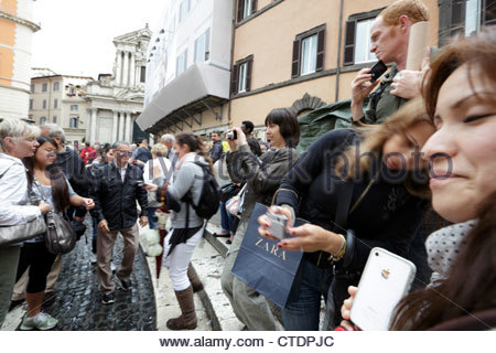 tourists crowd photographing at Trevi fountain Rome Italy - Stock Photo