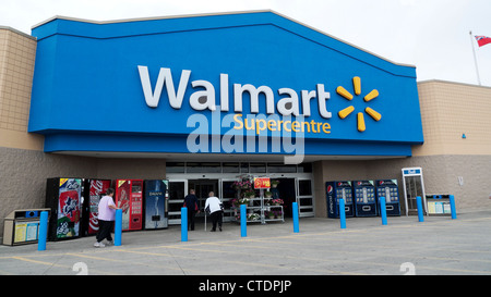 Exterior view of Walmart Supercentre Store with people walking towards entrance Ontario Canada  KATHY DEWITT - Stock Photo