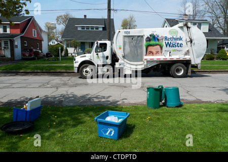 Garbage truck in residential street collecting household recycled waste paper Fort Erie Ontario Canada  KATHY DEWITT - Stock Photo
