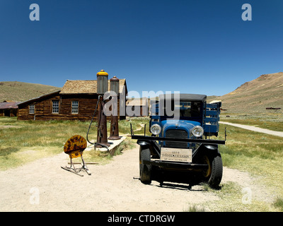 An old truck at a gas station in Bodie, a ghost town in California, United States. - Stock Photo