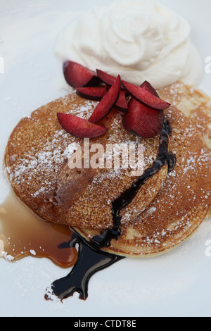 Crepes with plums and ice cream - Stock Photo