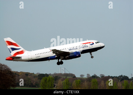 G-EUPZ - British Airways Airbus A319 131 aircraft takes off from Edinburgh airport - Stock Photo