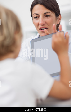 Doctor showing a tablet computer to a child Stock Photo