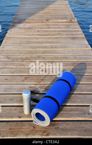 Yoga mat and water bottle - Stock Photo