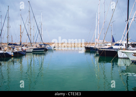 yachts in the harbor standing on an anchor - Stock Photo