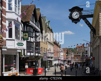 dh High street WINCHESTER HAMPSHIRE People in Winchester High Street clock pedestrianised city streets england - Stock Photo