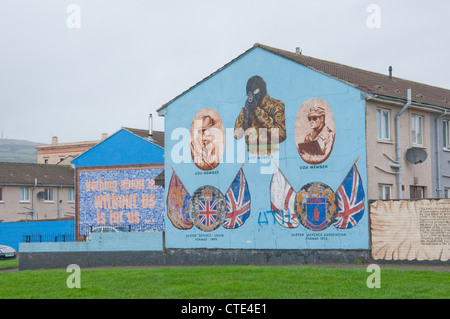 murals depicting loyalist assassins in the Shankill of West Belfast. - Stock Photo