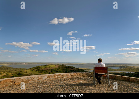 Man enjoying the view to Alqueva. Alqueva is the largest artificial lake in Europe with a surface of 252 km2. - Stock Photo