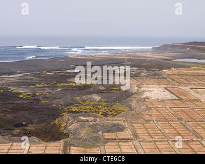 Abandoned salt pans beach and sea in Janubio Lanzarote - Stock Photo