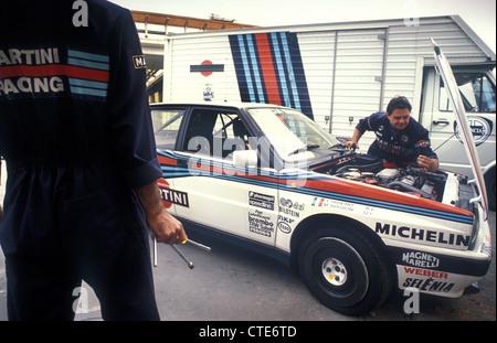 Lancia Martini rally team mechanics working on Miki Biasion 1990 Lancia HF Delta Integrale 16v rally car - Stock Photo