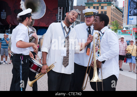 New Orleans  Lagniappe Brass Band giving an outdoor show on Esplanade de la Place des Arts during the Montreal Jazz - Stock Photo