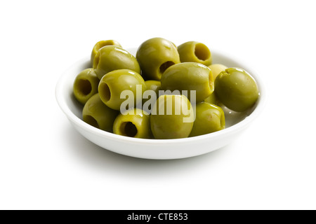 green olives in white bowl on white background - Stock Photo