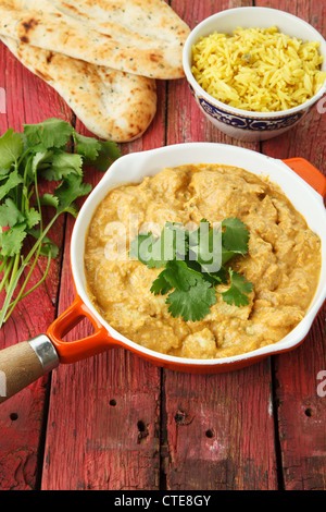 Indian Chicken Curry with Rice and Naan Breads - Stock Photo