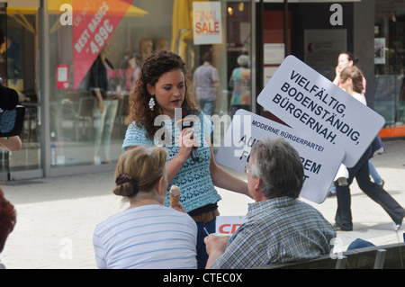 SWR Suedwestrundfunk German Television Crew Female Reporter interviews people in public street ENG - Heibronn Germany - Stock Photo
