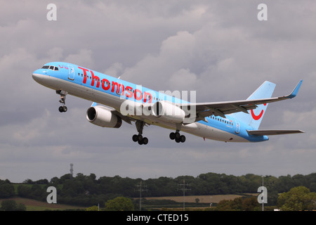 Thomson Boeing 757 jet airliner part of the TUI Group taking off - Stock Photo