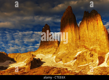 Towers at sunrise, Torres del Paine National Park, Patagonia, Chile - Stock Photo