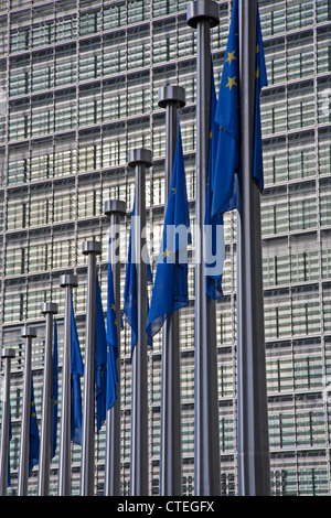 BRUSSELS - JUNE 24: European commission building and EU flags from Schumann square on June 24, 2012 in Brussels. - Stock Photo
